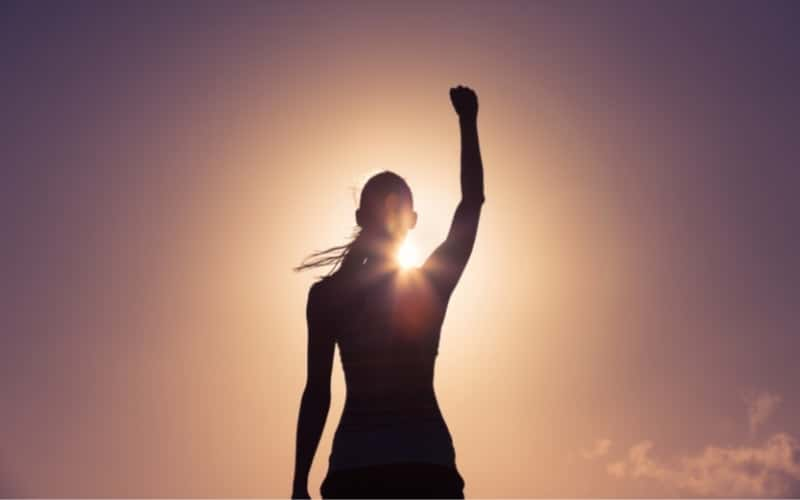 picture of a confident woman raising her fist