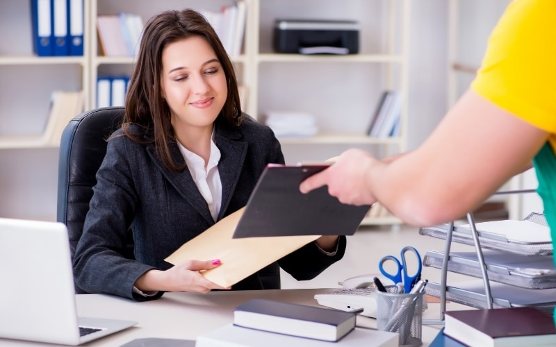 picture of a woman getting served divorce papers